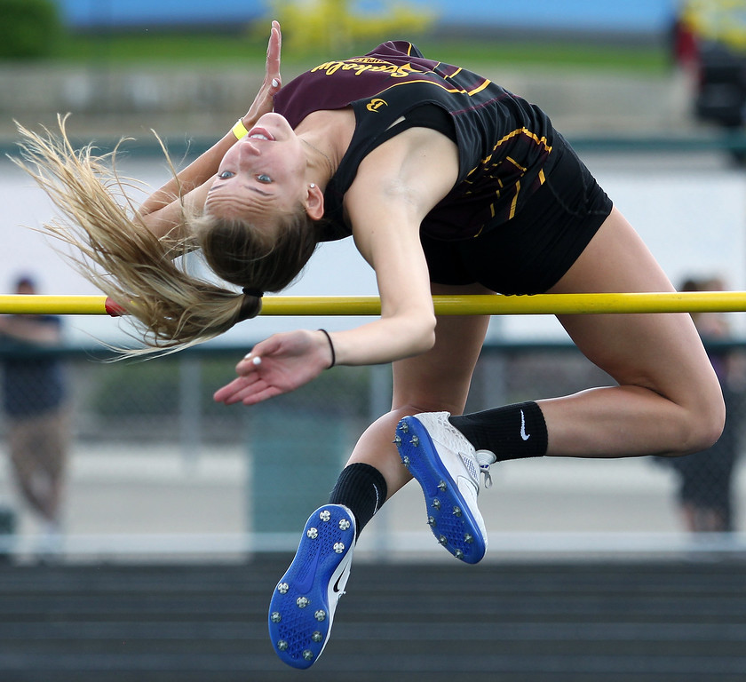 ". Heather Meadows, Birmingham Seaholm, clears the high jump bar at 5\' 3"" during regional final track action at West Bloomfield Saturday, May 19, 2018. Meadows jump captured first place honors and qualified her for state final competition. (For The Oakland Press / LARRY McKEE)"