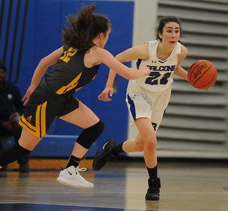 Laura Kucera (21) of Rochester brings the ball up court as Lauren Petersmark of Rochester Adams defends during the OAA White/Blue crossover game played on Tuesday February 5, 2019 at Rochester High School.  Kucera had 14 points but the Falcons lost 52-40. (Digital First Media photo by Ken Swart)