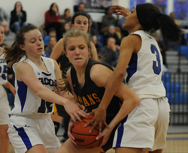 Sidney Swart (L) and Anna Winkler (R) of Rochester have Rochester Adams' Amelia Drahnak trapped during the OAA White/Blue crossover game played on Tuesday February 5, 2019 at Rochester High School.  The Falcons lost to the Highlanders 52-40.  (Digital First Media photo by Ken Swart)