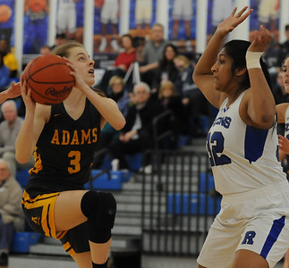 Nicole Claerhout (3) of Rochester Adams looks to shot over Rochester's Ananya Rangarajan during the OAA White/Blue crossover game played on Tuesday February 5, 2019 at Rochester High School.  Claerhout had 13 points to help lead the Highlanders to a 52-40 win. (Digital First Media photo by Ken Swart)
