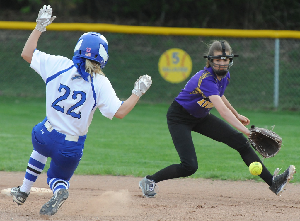 . Rochester\'s Harper Monica (22) slides safely into second base as Avondale\'s Mackenzie Down goes for the throw during the OAA White doubleheader played on Wednesday May 9, 2018 at Rochester.  Avondale won game one 12-9,  and the Falcons took the nightcap 9-6.  (Oakland Press photo by Ken Swart)