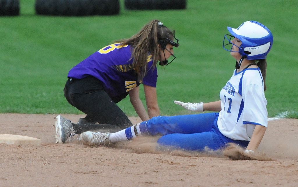 . Rochester\'s Megan Lorenzo (11) slides safely into third as Avondale\'s Emily Bowery tries for the tag during the OAA White doubleheader played on Wednesday May 9, 2018 at Rochester.  Avondale won game one 12-9,  and the Falcons took the nightcap 9-6.  (Oakland Press photo by Ken Swart)