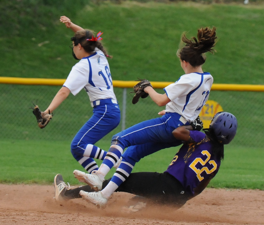 . Avondale\'s Toya Golden (22) collides with Rochester shortstop Megan Lorenzo as she steals second base during the OAA White doubleheader played on Wednesday May 9, 2018 at Rochester.  Avondale won game one 12-9,  and the Falcons took the nightcap 9-6.  (Oakland Press photo by Ken Swart)