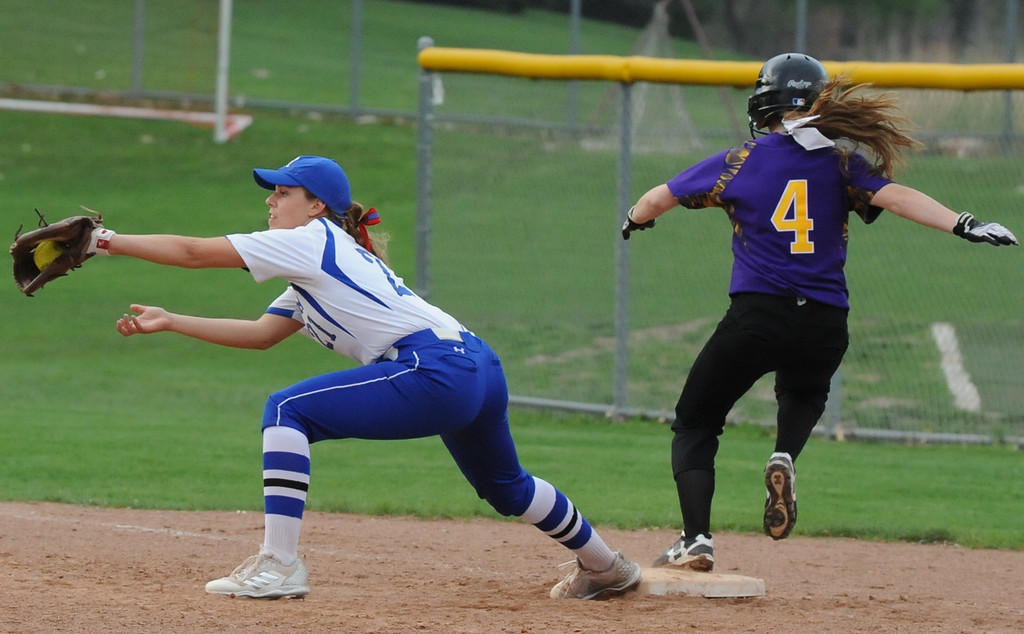 . Rochester first baseman Jenna Norgrove gets the putout on Avondale\'s Mackenzie Jankowksi (4) during the OAA White doubleheader played on Wednesday May 9, 2018 at Rochester.  Avondale won game one 12-9,  and the Falcons took the nightcap 9-6.  (Oakland Press photo by Ken Swart)