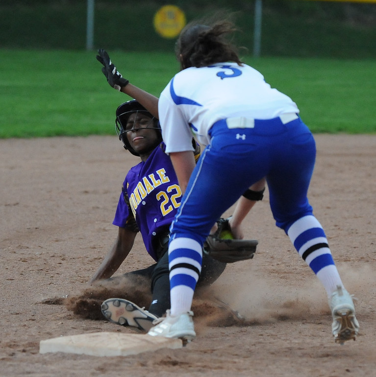 . Avondale\'s Toya Golden (22) gets tagged out by Rochester third baseman Emily Morrow during the OAA White doubleheader played on Wednesday May 9, 2018 at Rochester.  Avondale won game one 12-9,  and the Falcons took the nightcap 9-6.  (Oakland Press photo by Ken Swart)