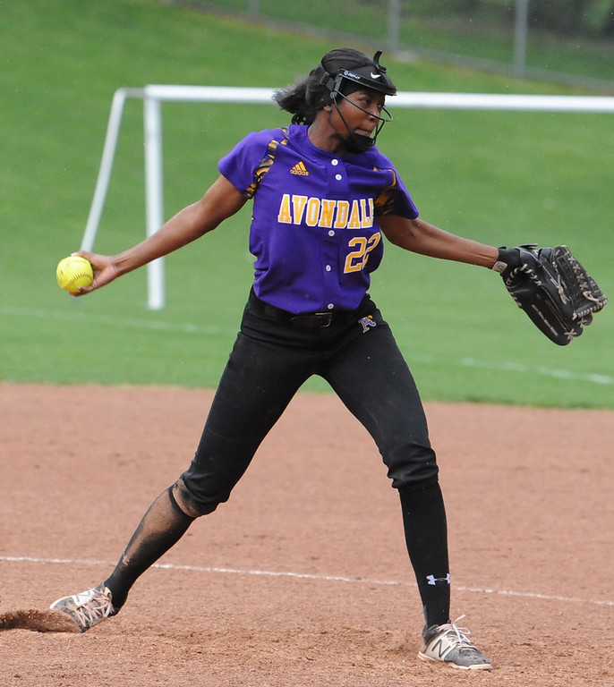 . Avondale\'s Toya Golden (22) delivers a pitch during the OAA White doubleheader against Rochester on Wednesday May 9, 2018 at Rochester.  Golden earned the game one win 12-9.  The Falcons took the nightcap 9-6.  (Oakland Press photo by Ken Swart)