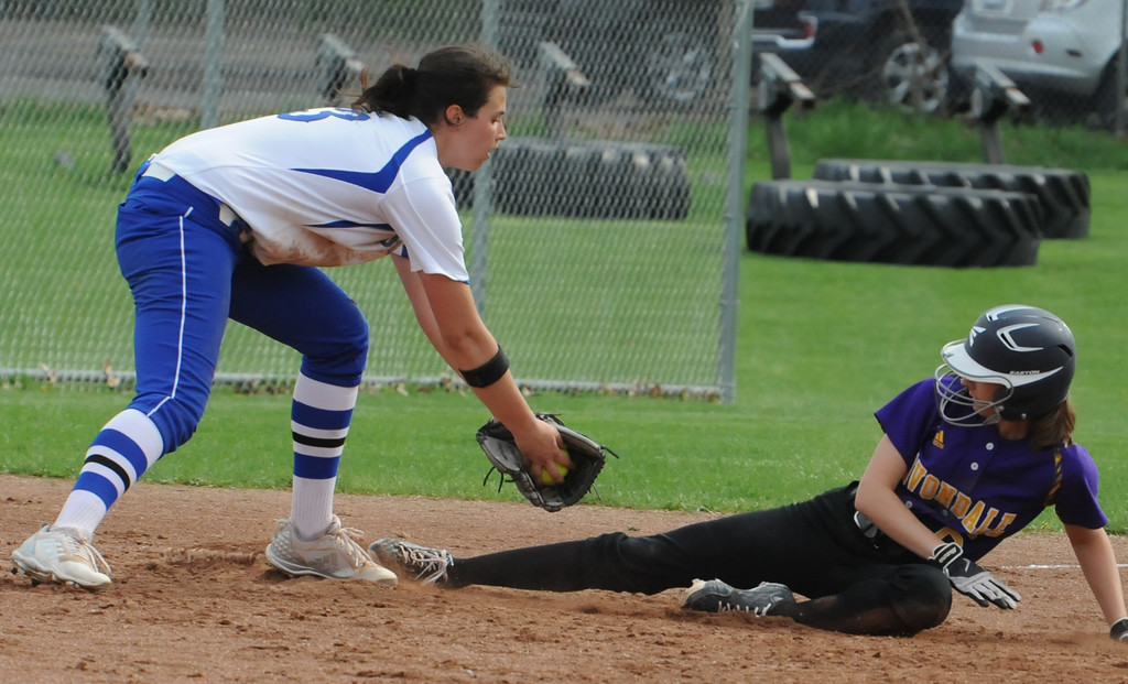 . Avondale\'s Mackenzie Down slides safely into third base as Rochester\'s Emily Morrow tries for the tag during the OAA White doubleheader played on Wednesday May 9, 2018 at Rochester.  Avondale won game one 12-9,  and the Falcons took the nightcap 9-6.  (Oakland Press photo by Ken Swart)