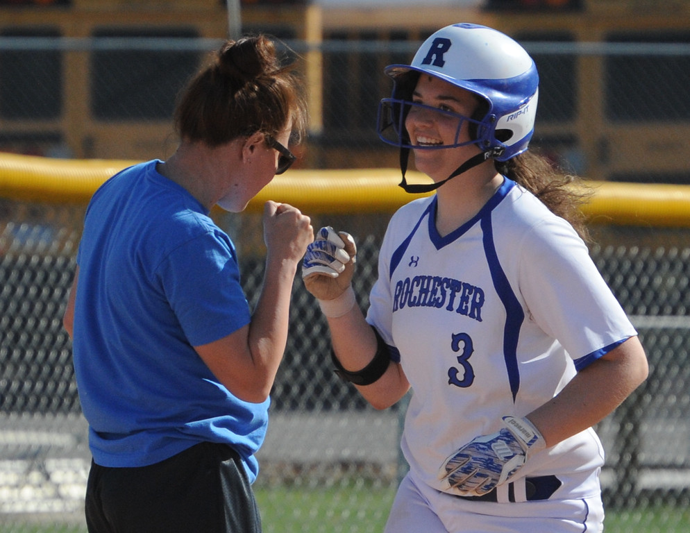 . Rochester\'s Emily Morrow gets congratulations from head coach Laura Guzman on her 2 run home run in the first game against Berkley.  The Falcons swept the doubleheader over Berkley 10-2, 14-0 (5 innings).  The games were played on Tuesday May 1, 2018 at Rochester High School.  (Oakland Press photo by Ken Swart)