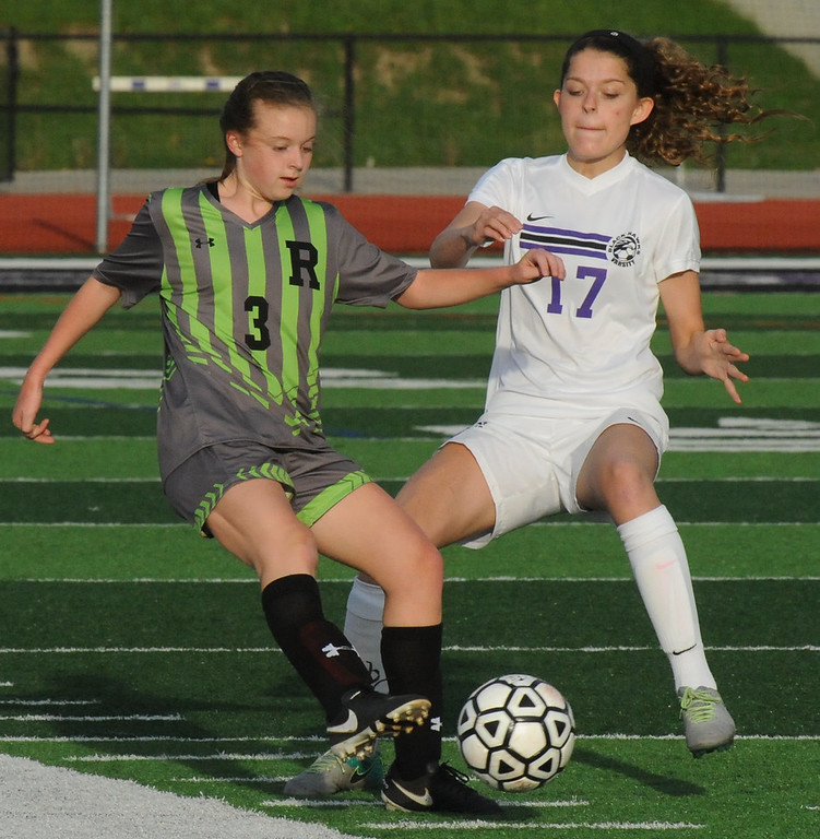 . Rochester\'s Sidney Swart (3) clears the ball past Kyra Schofield (17) during the OAA Red match played on Thursday May 17, 2018 at Bloomfield Hills High School.  The Falcons defeated the Black Hawks 1-0.  (Oakland Press photo by Ken Swart)