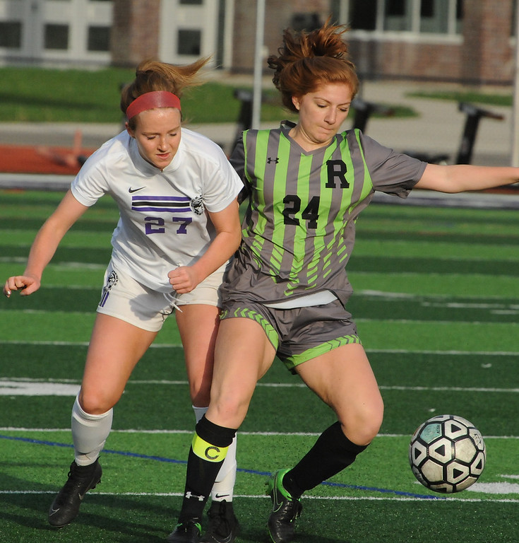 . Rochester\'s Jillian Lekosiotis (24) and Sydney Huston (27) of Bloomfield Hills battle for the ball during the OAA Red match played on Thursday May 17, 2018 at Bloomfield Hills High School.  The Falcons defeated the Black Hawks 1-0.  (Oakland Press photo by Ken Swart)