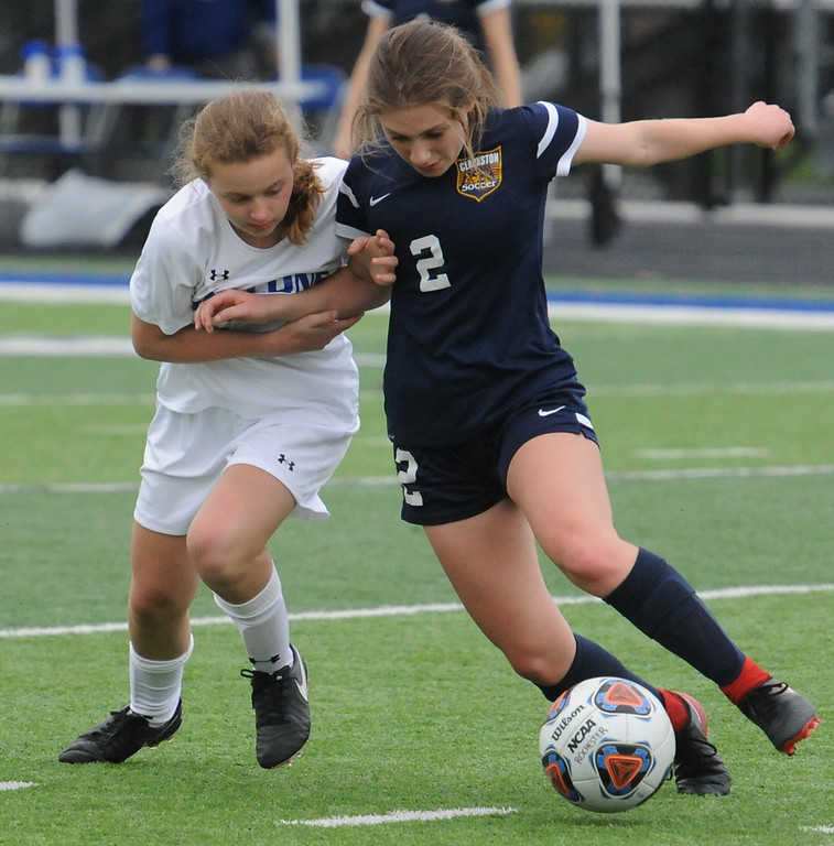 . Talia Scicluna (2) of Clarkston tries to move around Sidney Swart of Rochester during the OAA Red matchup played on Thursday May 3, 2018 at Rochester High School.  The teams played to a 0--0 draw.  (Oakland Press photo by Ken Swart)