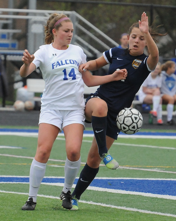 . Rochester\'s Kaitlin DuCharme (14) and Clarkston\'s Paigeee Olivario battle for the ball during the OAA Red matchup played on Thursday May 3, 2018 at Rochester High School.  The teams played to a 0--0 draw.  (Oakland Press photo by Ken Swart)