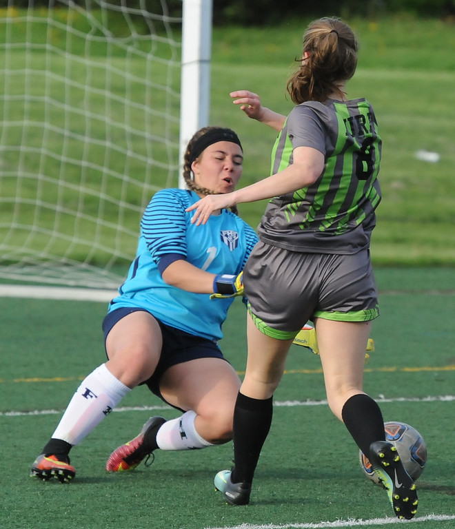 . Farmington goalkeeper Alex Thomas comes out to make a save against Rochester\'s Emily Murphy during the OAA Crossover match played on Tuesday May 15, 2018 at Farmington High School.  Farmington lost to Rochester 2-0.  (Oakland Press photo by Ken Swart)