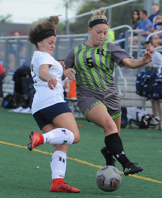 . Rochester\'s Mckenzie Gruzwalski (5) battles for the ball with Farmington\'s Emily Pace during the OAA Crossover match played on Tuesday May 15, 2018 at Farmington High School.  Rochester defeated Farmington 2-0.  (Oakland Press photo by Ken Swart)