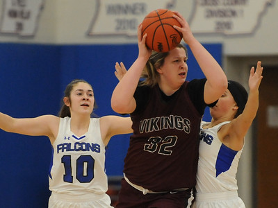 Hazel Park's Megan Mauney (32) looks for a team mate as Rochester's Mary Derkacz (10) and Payton Johnson defend during the OAA Blue battle played on Wednesday February 13, 2019 at Rochester HS. Mauney had a team high 8 points but the Vikings lost to the Falcons 53-22.  (KEN SWART - for Media News Group)