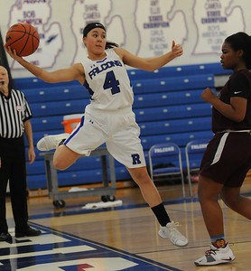 Payton Johnson (4) of Rochester saves the ball as Hazel Park's Kiara Odoms looks on during the OAA Blue battle played on Wednesday February 13, 2019 at Rochester HS. The Falcons defeated the Vikings 53-22 to improve their league record to 7-0.  (KEN SWART - for Media News Group)
