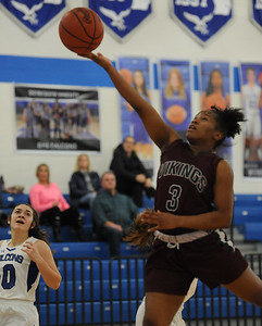 Hazel Park's Heaven Varner (3) lays in two of her 7 points as Rochester's Mary Derkacz (10) follows the play during the OAA Blue battle played on Wednesday February 13, 2019 at Rochester HS. The Vikings lost to the Falcons 53-22.  (KEN SWART - for Media News Group)