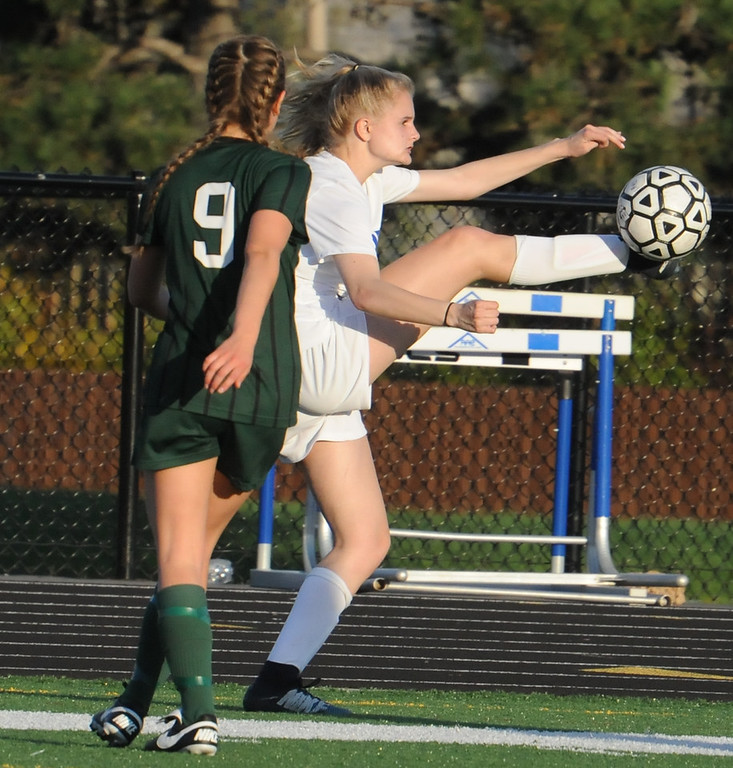 . Rochester\'s Lily Cooper (R) gets a leg up on Lake Orion\'s Grace Stetsko (9) during the OAA Red/Blue crossover match played on Friday May 4, 2018 at Rochester High School.  The Falcons defeated the Dragons 3-0. (Oakland Press photo by Ken Swart)
