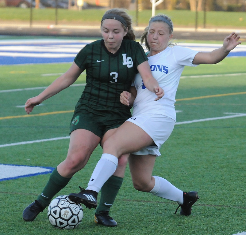 . Lake Orion\'s Haley Negri (3) and Rochester\'s McKenzie Gruzwalski fight for possession during the OAA Red/Blue crossover match played on Friday May 4, 2018 at Rochester High School.  The Dragons lost to the Falcons 3-0. (Oakland Press photo by Ken Swart)