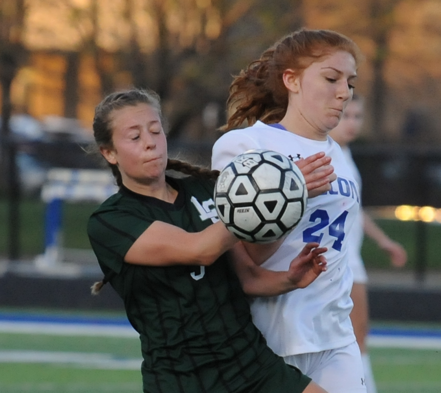 . Rochester\'s Jillian Lekosiotis (24) and Lake Orion\'s Grace Stetsko battle for the ball during the OAA Red/Blue crossover match played on Friday May 4, 2018 at Rochester High School.  The Falcons defeated the Dragons 3-0. (Oakland Press photo by Ken Swart)