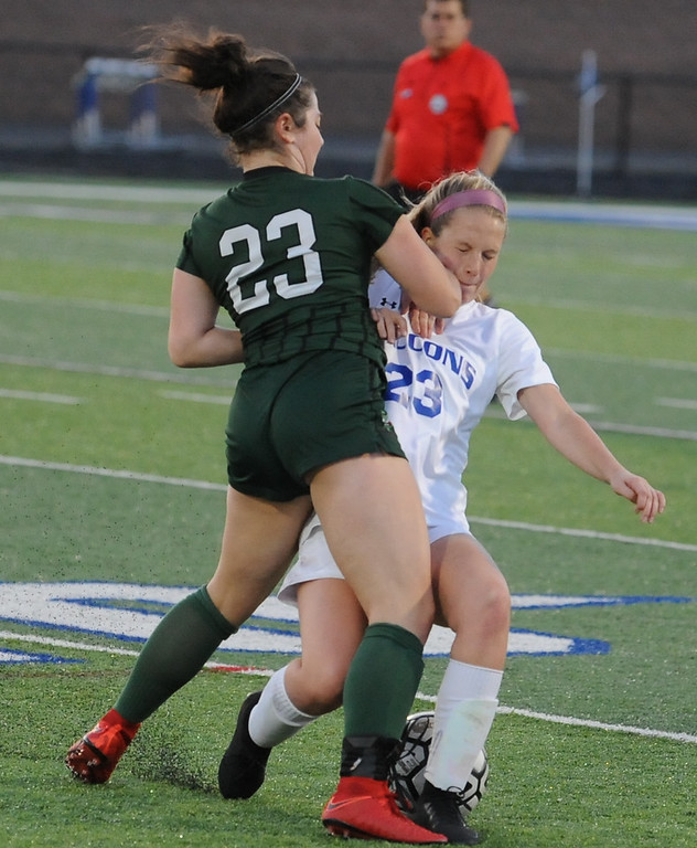 . Rochester\'s Mackenzie Smith (R) collides with Matia Rourke (L) during the OAA Red/Blue crossover match played on Friday May 4, 2018 at Rochester High School.  The Falcons defeated the Dragons 3-0. (Oakland Press photo by Ken Swart)