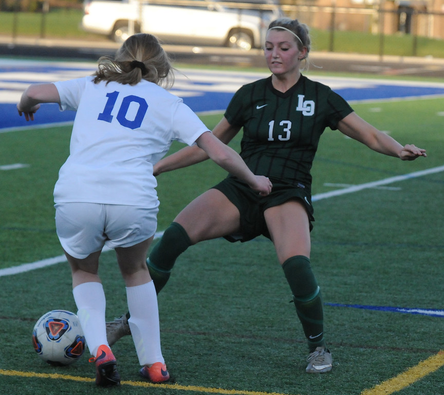 . The Rochester Falcons defeated the Lake Orion Dragons 3-0 in the OAA Red/Blue crossover match played on Friday May 4, 2018 at Rochester High School.  (Oakland Press photo by Ken Swart)