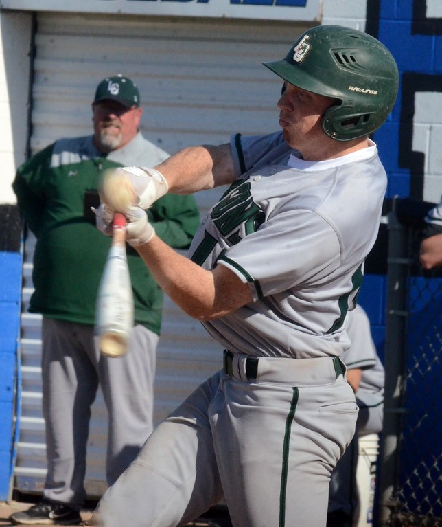 . The Lake Orion baseball team edged Rochester for 2-1 and 4-3 victories on Monday, giving the Dragons a 3-game edge over the Falcons in the OAA Red standings. (Oakland Press photo gallery by Drew Ellis)