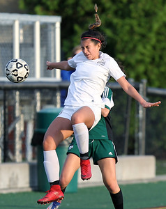 Olivia Graham, Birmingham Seaholm, makes a header pass during varsity soccer action against West Bloomfield at Seaholm High School Thursday, May 17, 2018. (For The Oakland Press / LARRY McKEE)
