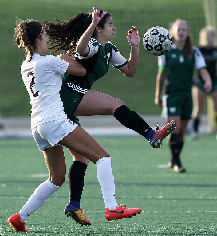 . Fotini Demetriou (2), Birmingham Seaholm, collides with Maya Madi, West Bloomfield, during varsity soccer action at Seaholm High School Thursday, May 17, 2018. (For The Oakland Press / LARRY McKEE)