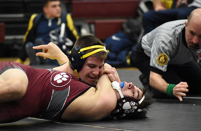 Hartland's Corey Cavanaugh scores three near-fall points during his win over U-D Jesuit's Alex Drewek Wednesday night. Cavanaugh pinned Drewek in 3:18 during his team's 71-12 victory over the Cubs. (JASON SCHMITT - For Media News Group)