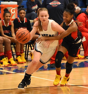 Royal Oak sophomore Sarah Soraghan drives past Southfield A&T's Nia Lawson Tuesday night during the Warriors' 60-47 victory over the Ravens. (Digital First Media photo by Jason Schmitt)