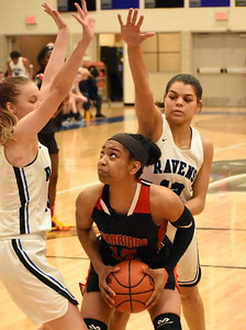 Southfield A&T junior Cheyenne McEvans prepares to go up for a shot as Royal Oak's Sarah Soraghan (left) and Nila Coney guard her during the second half of their game at Royal Oak High School Tuesday night. (Digital First Media photo by Jason Schmitt)