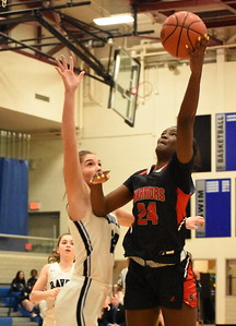 Southfield A&T senior Alexis Johnson (24) goes up for two as Royal Oak's Samantha Potter defends during the first half Tuesday night. (Digital First Media photo by Jason Schmitt)