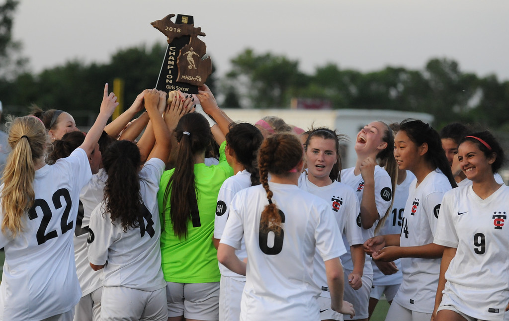 . The Troy Colts celebrate their 5-0 win over Grosse Pointe North to win the MHSAA D1 Regional played on Thursday June 7, 2018 at Troy Athens HS.  The Colts will play Novi in next Tuesday\'s Semi-final match at Stoney Creek HS.  (Oakland Press photo by Ken Swart)