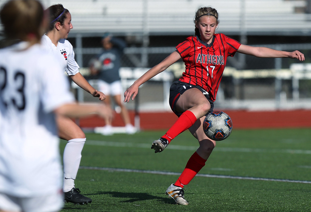 . Brooke March, Troy Athens, settles the ball down at midfield during varsity soccer action at Troy High School Thursday, May 10, 2018. Athens fell to Troy 2-1. (For The Oakland Press / LARRY McKEE)