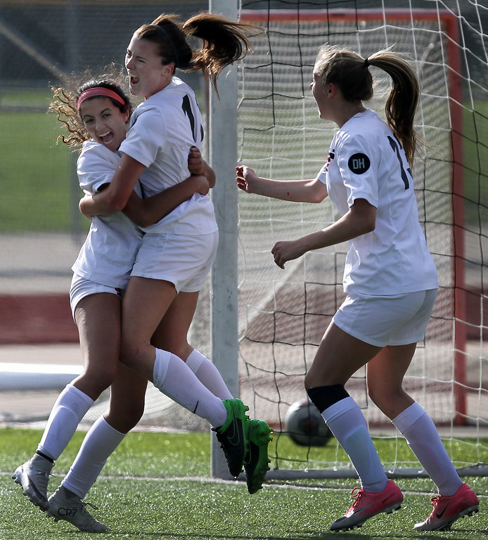 . Steph O\'Keefe (center), Troy, celebrates scoring a goal with teammates Tahra Brodbine (left) and Sophia Bongiovanni during varsity soccer action against cross town rival Troy Athens Thursday, May 10, 2018. The Colts defeated visiting Athens 2-1. (For The Oakland Press / LARRY McKEE)