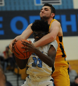 Quinton Fly (33) of Waterford Mott grabs a rebound in front of Walled Lake Central's Gabe Matti during the Lakes Valley Conference game played on Friday February 1, 2019 at Waterford Mott HS.  The Corsairs defeated the Vikings 84-57. (Digital First Media photo by Ken Swart)