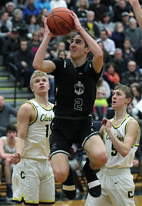 Jake Lansaw (2), West Bloomfield, goes up for a shot in the paint during varsity basketball action at Clarkston High School Friday, Feb. 1, 2019. The Lakers fell to home team Wolves 69-45. (For The Oakland Press / LARRY McKEE)