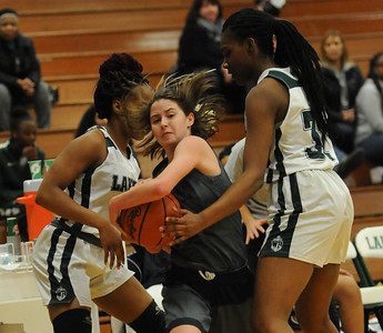Autumn Bartlett (C) of Farmington splits the West Bloomfield defenders Maliyah Williams (LF) and Ikia Elam (R) during the OAA White game played on Monday February 18, 2019 at West Bloomfield HS.  Bartlett had a team high 12 points but the Falcons lost 71-26.  (KEN SWART for Media News Group)