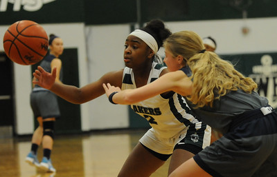 Jade Goodloe (2) of West Bloomfield and Emily Flynn of Farmington reach for a loose ball during the OAA White game played on Monday February 18, 2019 at West Bloomfield HS.  The Lakers go to 11-0 in conference play with a 71-26 win.  (KEN SWART for Media News Group)