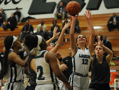 Grace Yaldoo  (12) of West Bloomfield puts up a shot in front of Farmington's Kelly Flynn (2) during the OAA White game played on Monday February 18, 2019 at West Bloomfield HS.  Yaldoo had a game high 19 points to help lead the Lakers to a 71-26 win.  (KEN SWART for Media News Group)