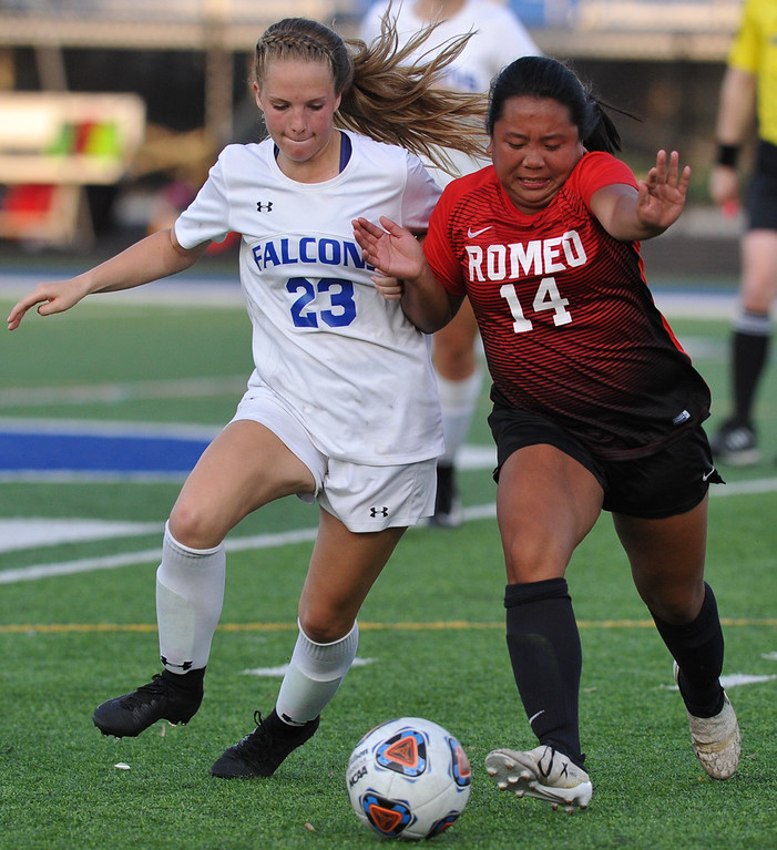 . Rochester\'s Mackenzie Smity (23) Romeo\'s Julienne Ciacico (14) battle for the ball during the MHSAA D1 Soccer district quarterfinal match played on Tuesday May 29, 2018 at Rochester High School.  The Falcons defeated the Bulldogs 1-0. (Digital First Media photo by  Ken Swart)