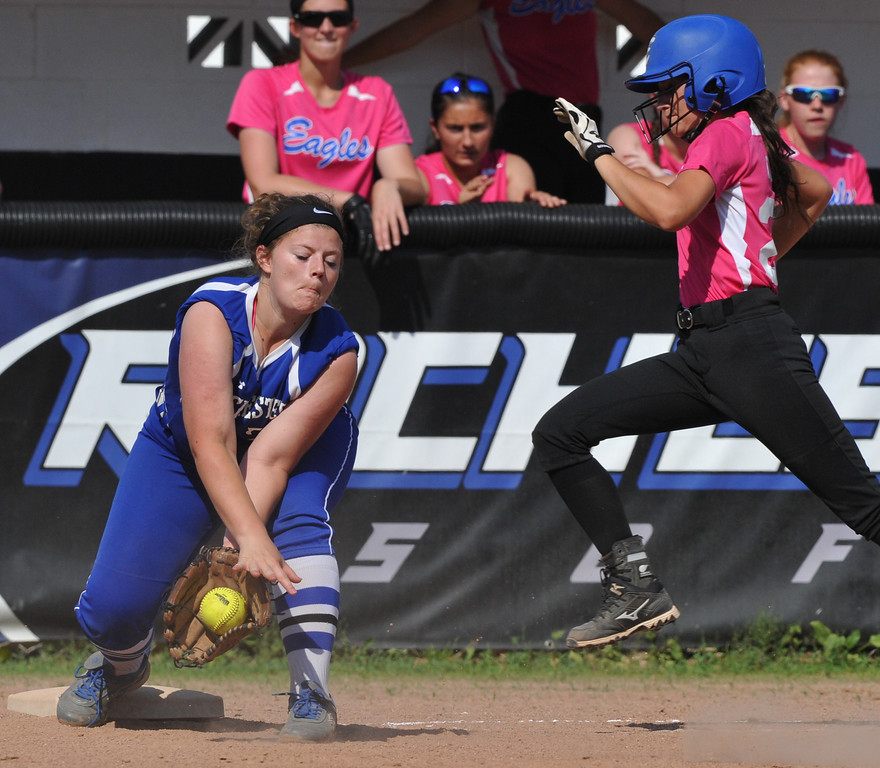 . Rochester first baseman Catie Troy scoops up the throw to complete the put out against Utica Eisenhower\'s Emily Oumelaz during the MHSAA D1 softball pre-district game played on Tuesday May 29, 2018 at Rochester High School. The Eagles defeated the Falcons 9-0. (Digital First Media Photo by Ken Swart)