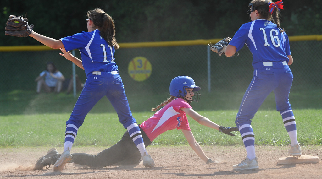 . Utica Eisenhower\'s Sydney Bogden dives back safely to second base as Rochester\'s Megan Lorenzo (11) and Abby Michelz (16) try for the out during MHSAA D1 softball pre-district game played on Tuesday May 29, 2018 at Rochester High School. The Eagles defeated the Falcons 9-0. (Digital First Media Photo by Ken Swart)
