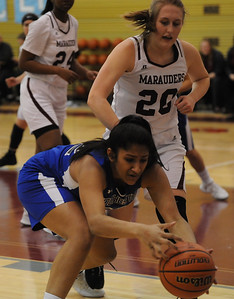 Ananya Rangarajan grabs the ball in front of Warren Mott's Lanie Saroli (20) during the OAA/MAC match up played on Friday February 8, 2019 at Warren Mott HS. The Falcons defeated the Marauders 37-26. (Digital First Media photo by Ken Swart)
