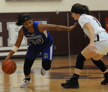 Rochester's Tori Hawkins (L) looks to move past Warren Mott's Ashley Younis during the OAA/MAC match up played on Friday February 8, 2019 at Warren Mott HS. The Falcons defeated the Marauders 37-26. (Digital First Media photo by Ken Swart)