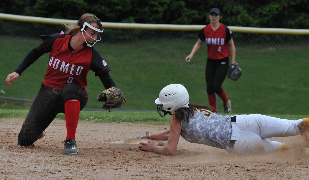 . Rochester Adams\' Mary Nash slides safely into second base as Romeo\'s Jordyn Chapman tries for the tag during the MHSAA D1 district played at Stoney Creek HS on Saturday June 2, 2018.  Adams defeated Romeo 5-4 in the semi-final.  (Digital First Media photo by Ken Swart)