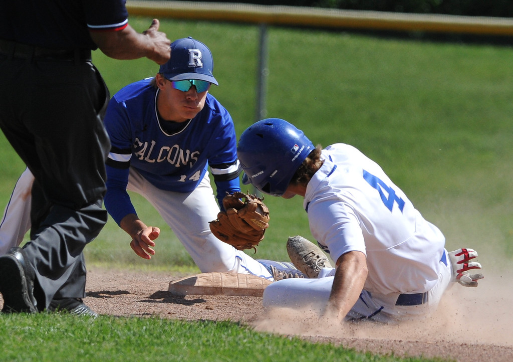 . Rochester\'s Ben Zuckerberg tags out Eisenhower\'s Andrew Grajewski at 2nd base during the MHSAA D1 baseball district played at Stoney Creek HS on Saturday June 2, 2018.  The Eagles defeated the Falcons 9-2 to win the title.   (Digital First Media photo by Ken Swart)