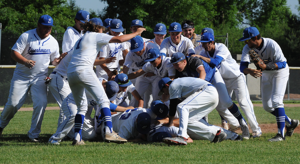 . Utica Eisenhower celebrates with a dog pile as they captured the MHSAA D1 baseball district played at Stoney Creek HS on Saturday June 2, 2018.  The Eagles defeated Stoney Creek 3-0 in the semi-final and Rochester 9-2 in the final.  Rochester defeated Romeo 5-3 in the other semi-final.  (Digital First Media photo by Ken Swart)