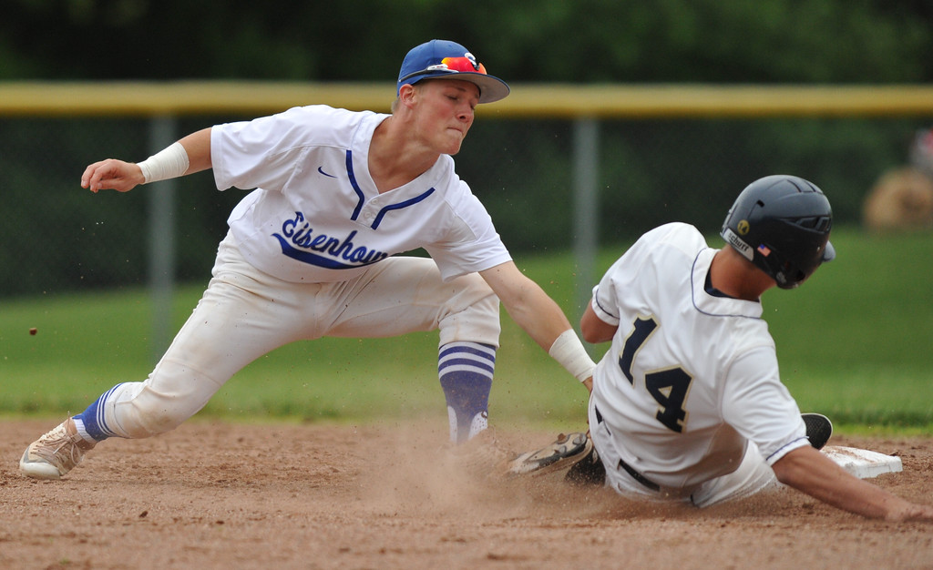 . Utica Eisenhower\'s Jake Miller tags our Stoney Creek\'s Isaac McKay (14) at 2nd base during the MHSAA D1 baseball district played at Stoney Creek HS on Saturday June 2, 2018.  The Eagles defeated Stoney Creek 3-0 in the semi-final and Rochester 9-2 in the final.  Rochester defeated Romeo 5-3 in the other semi-final.  (Digital First Media photo by Ken Swart)
